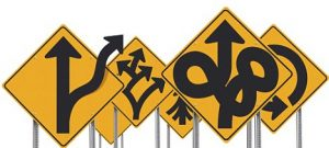 Assortment of unusual confusing road signs over a white background.